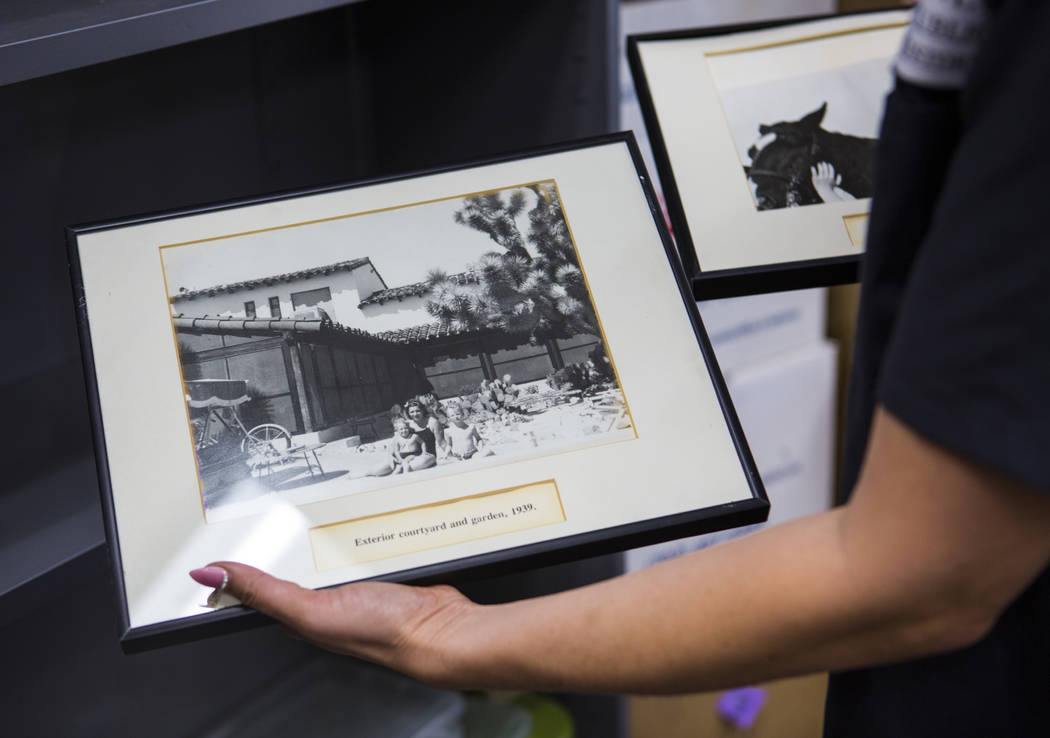 Deirdre Clemente, associate director of the UNLV public history program, holds a pair of framed ...