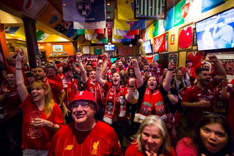 Liverpool fans, including Allison Gavin, center, and Shannon Theobald, right, both of Cleveland ...