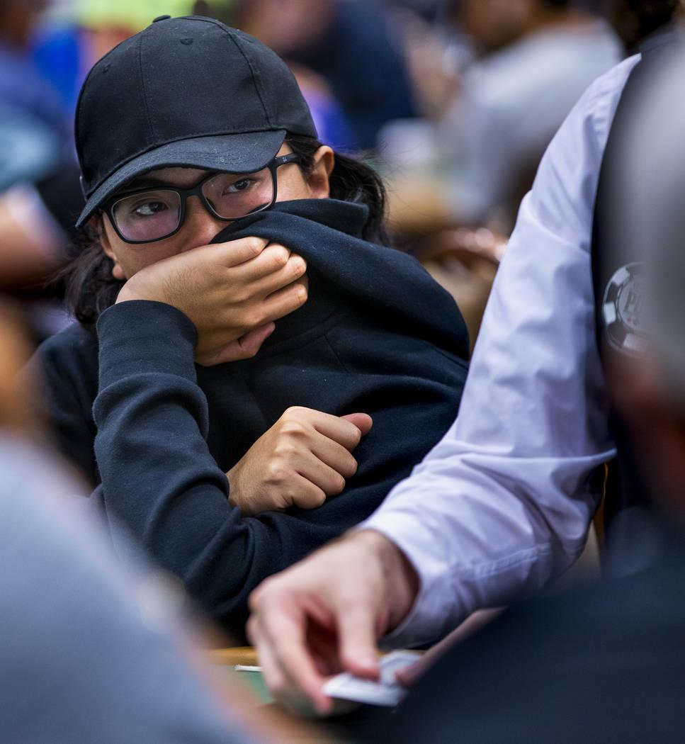 Kwok Chun Kong, of Hong Kong, attempts to keep all tells hidden at the table during the The Big ...