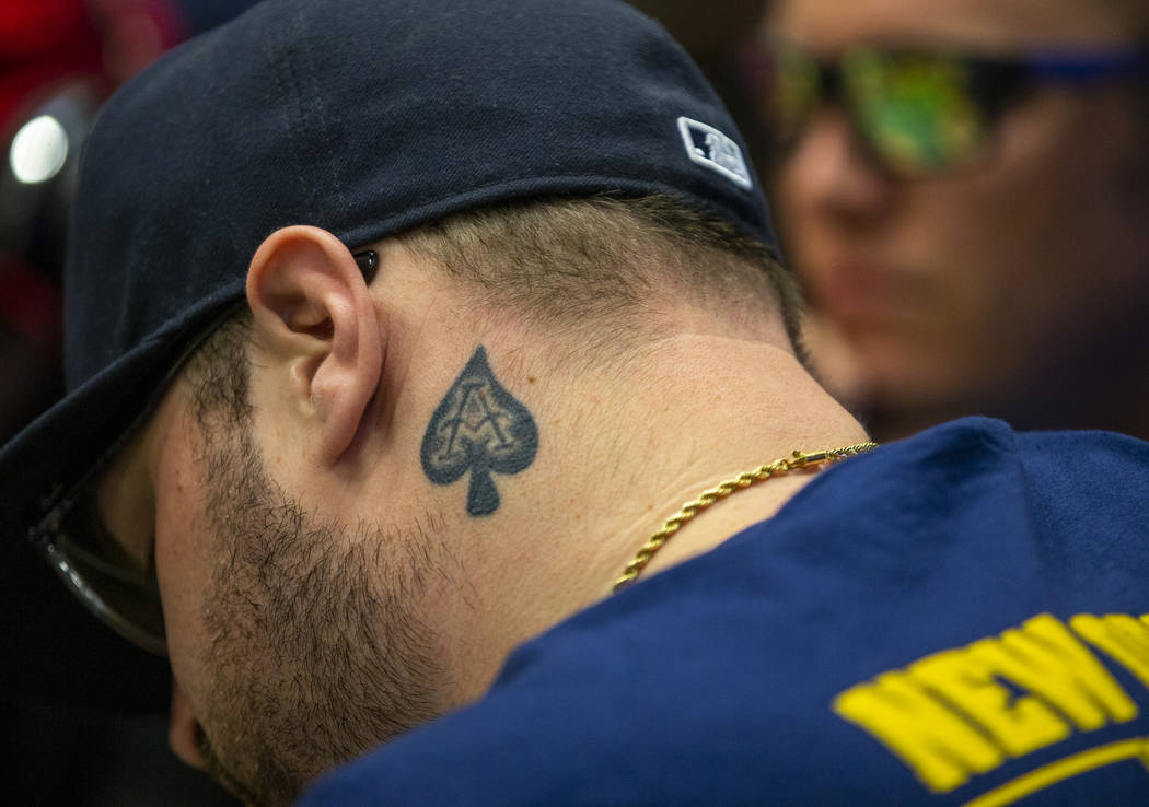 A poker player has the ace of spades tattooed on his neck during the The Big 50, a $500 buy-in, ...