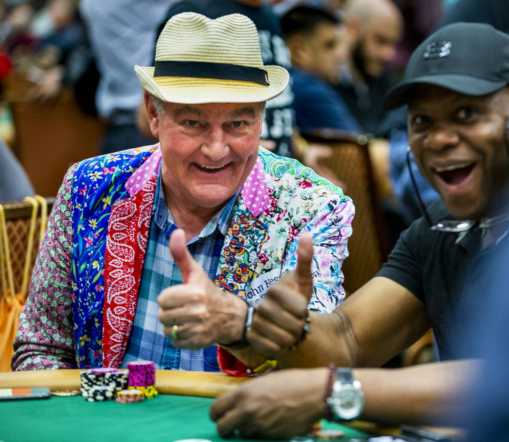 Professional poker player John Hesp, of Bridlington, U.K., left, poses for a photo with another ...