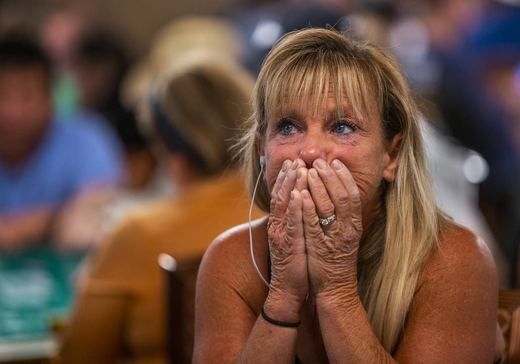 Kim Emmett, of Chicago, reacts as stakes get high during the The Big 50, a $500 buy-in, no-limi ...