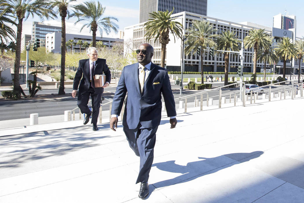 Former Las Vegas City Councilman Ricki Barlow prepares to enter the Lloyd D George Courthouse i ...