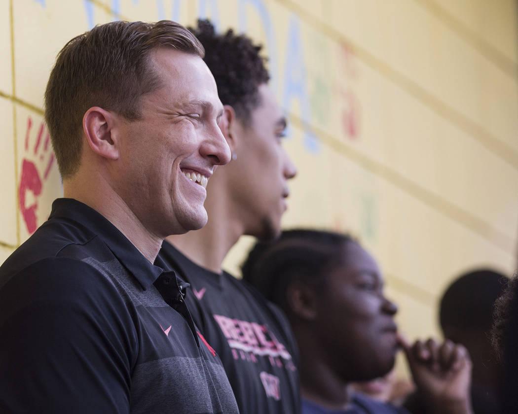 UNLV head basketball coach T.J. Otzelberger, left, jokes around with kids at the Nevada Youth N ...