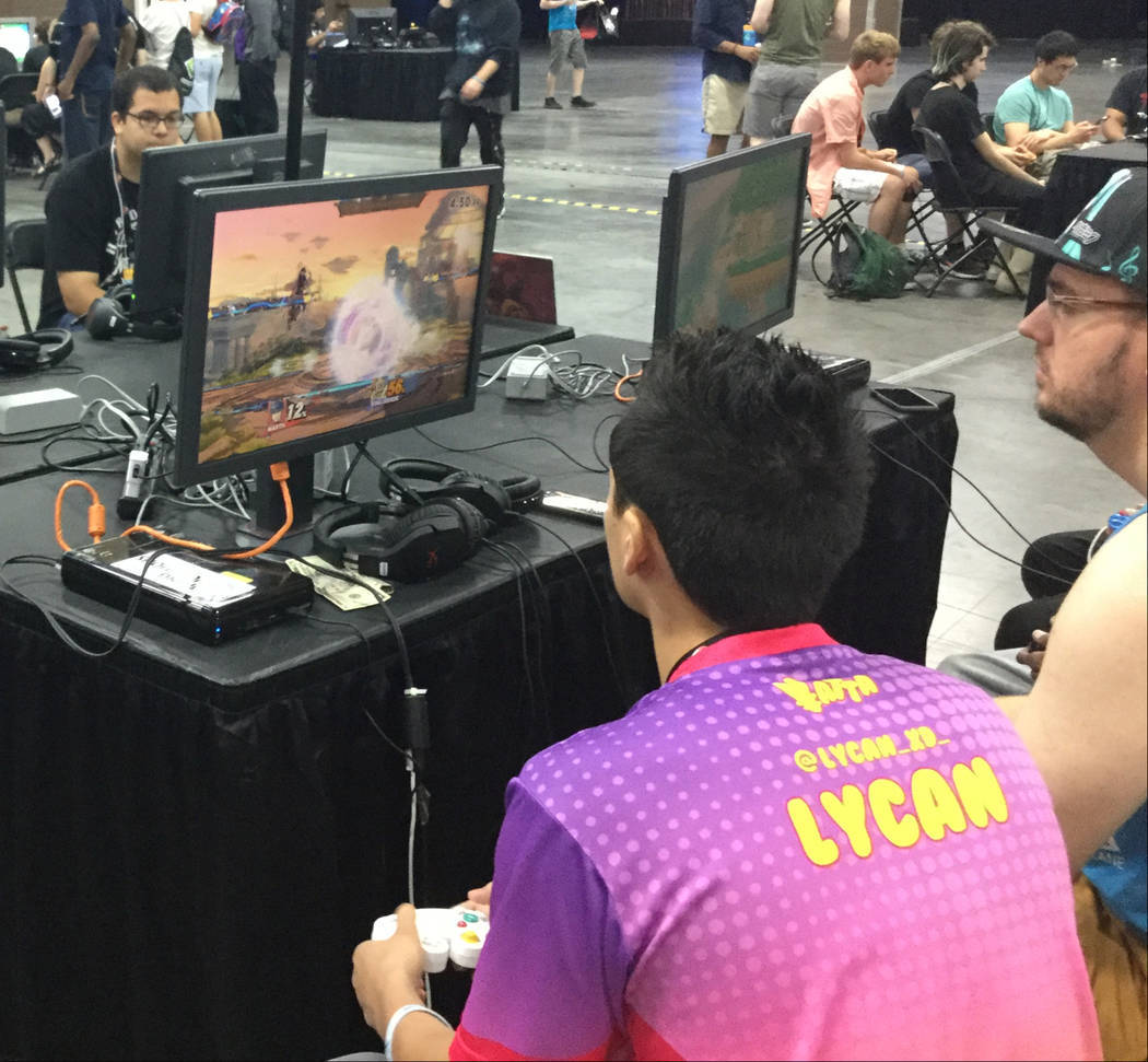 Jordan Aguda, participates in a money match, as noted by the cash at the bottom of the monitor, ...