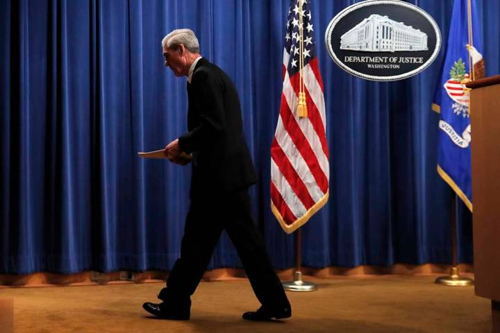 Special counsel Robert Mueller walks from the podium after speaking at the Department of Justic ...