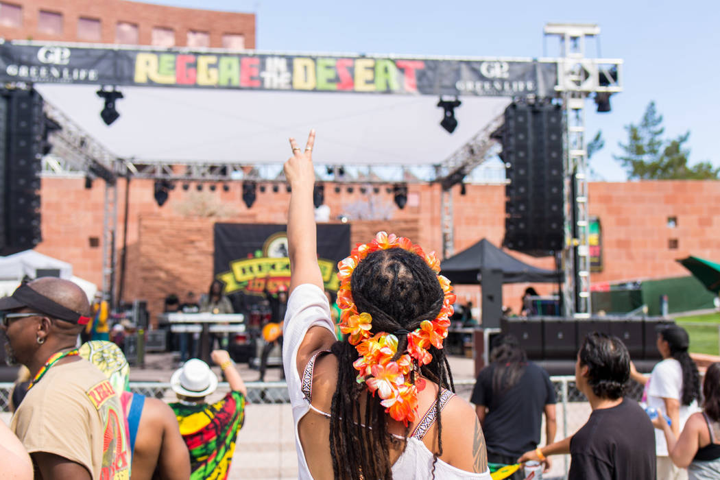 A crowd dances and sings to live reggae music at the Clark County Amphitheatre during Reggae in ...