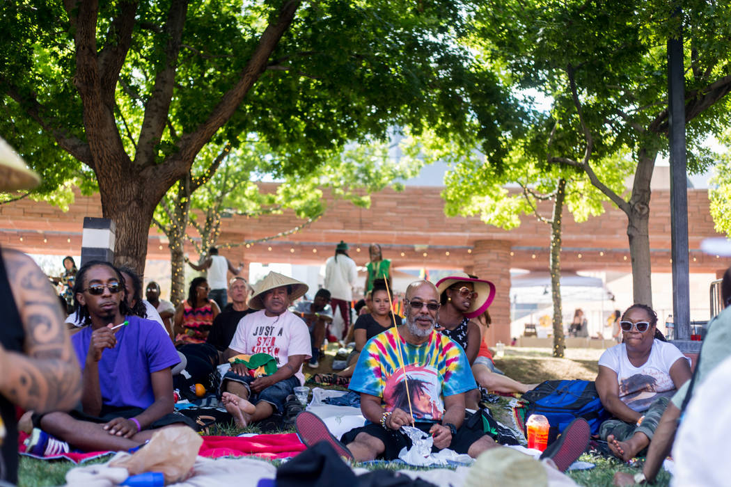 A crowd listens to live reggae music at the Clark County Amphitheatre during Reggae in the Dese ...