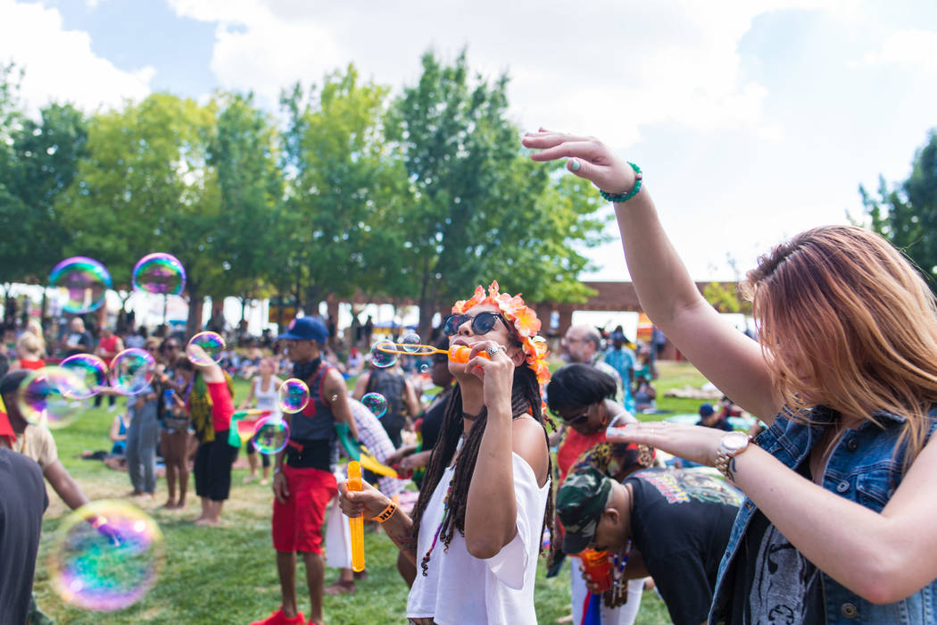 Tiffany Baez from New Jersey blows bubbles during live music at the Clark County Amphitheatre d ...