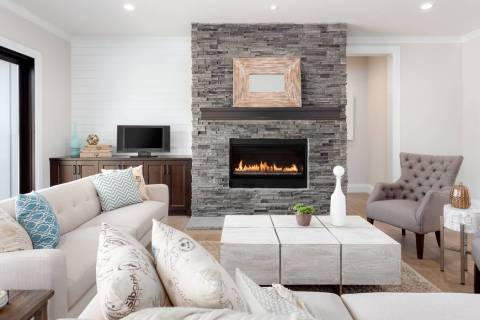 Stone fireplaces are not new, but having the stone go floor to ceiling is especially popular no ...