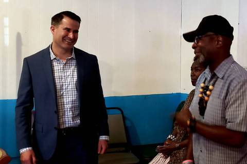 U.S. Rep. Seth Moulton, D-Mass, speaks to Rodney Smith, right, at a veterans town hall meeting ...