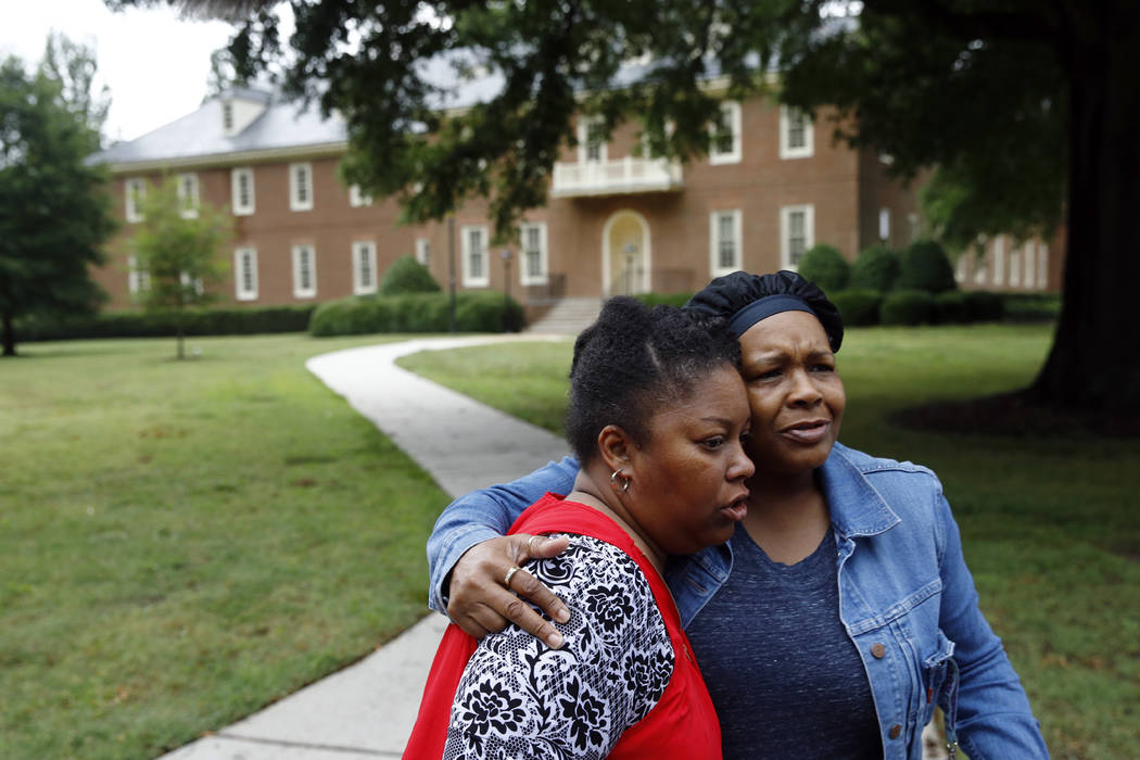 Shelia Cook, left, and Renee Russell, members of Mount Olive Baptist Church, embrace after pray ...