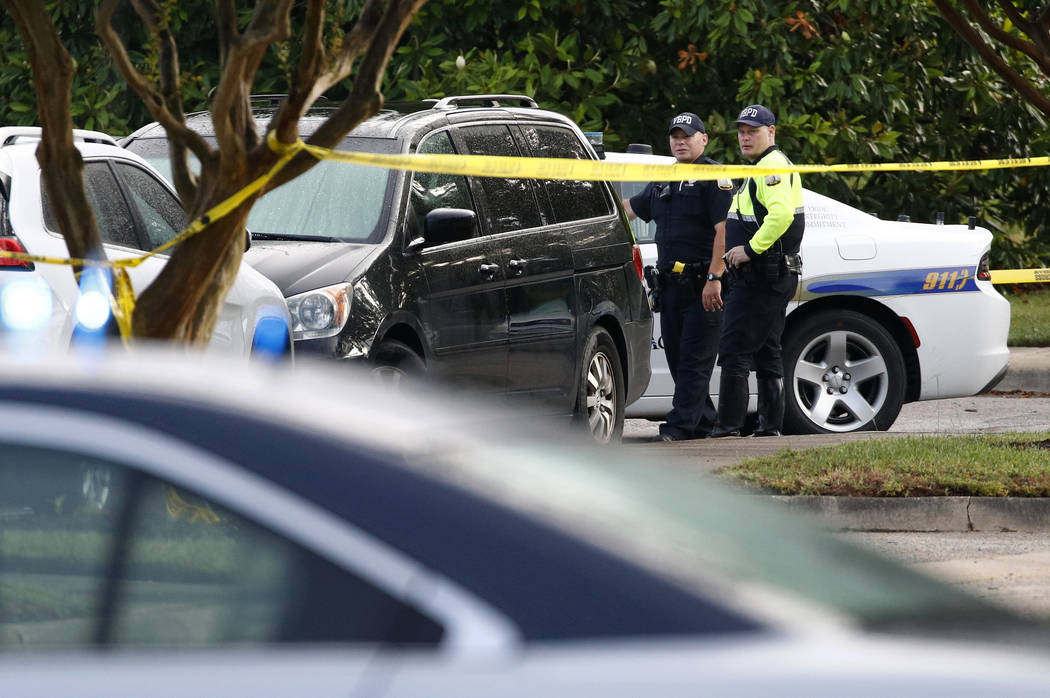 Law enforcement officials work outside a municipal building that was the scene of a shooting, S ...