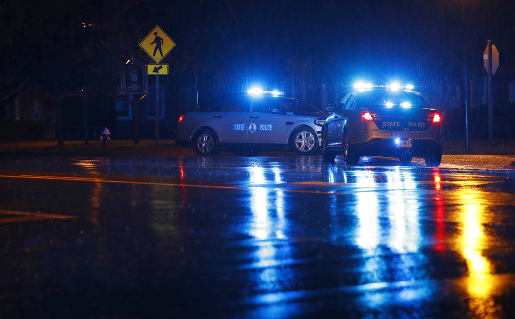 Virginia State Police vehicles block a street near the scene of a shooting at a municipal build ...