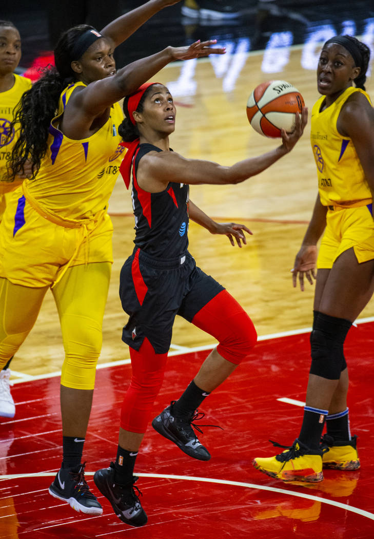 Las Vegas Aces guard Sydney Colson (51) gets off a reverse lay up past Los Angeles Sparks cente ...