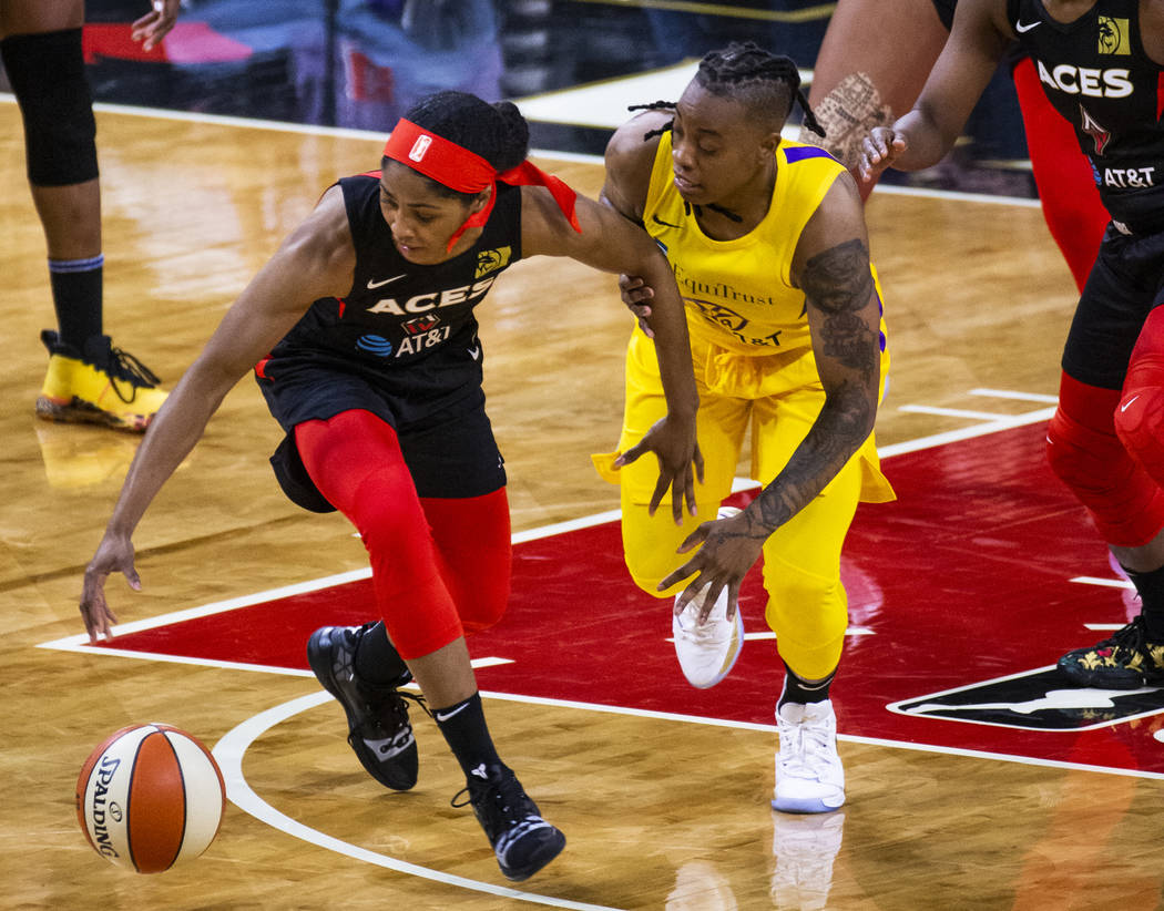Las Vegas Aces guard Sydney Colson (51) steals the ball from Los Angeles Sparks guard Riquna Wi ...