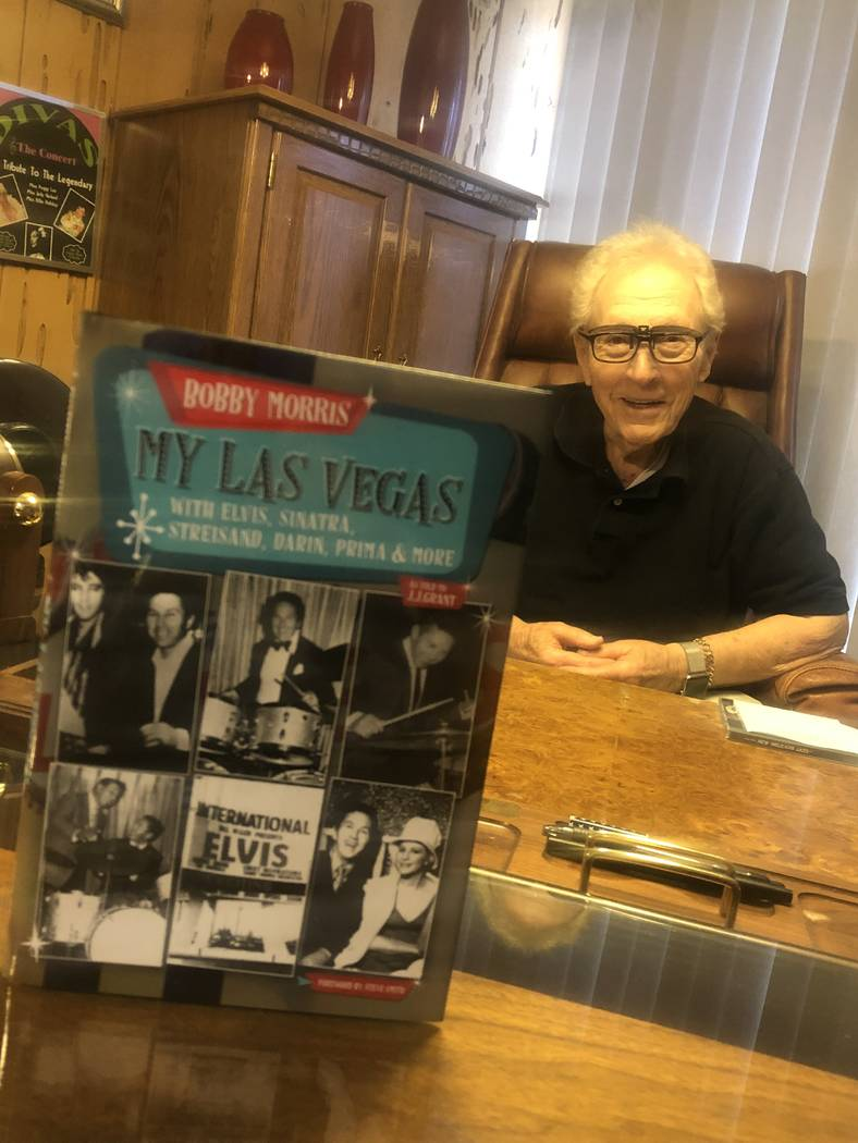 "Drumming icon Bobby Morris is shown with his new book, ""My Las Vegas,"" at his office in Las Veg ..."