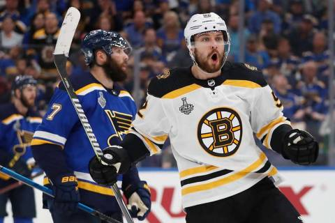 Boston Bruins center Sean Kuraly (52) celebrates after scoring against the St. Louis Blues duri ...