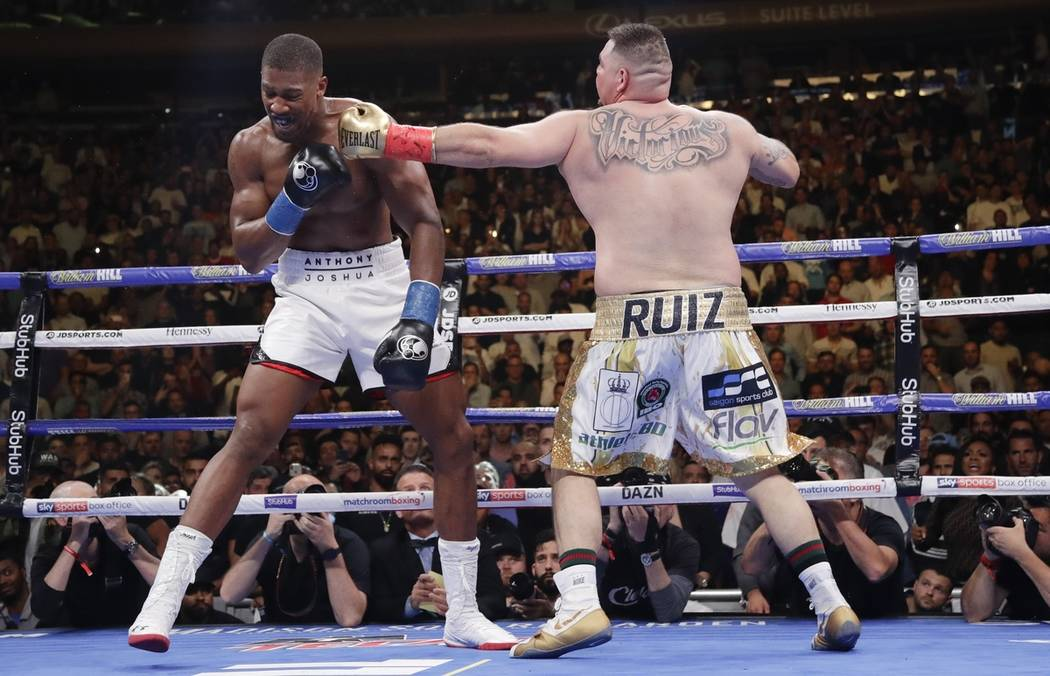 Andy Ruiz, right, punches Anthony Joshua during the third round of a heavyweight title boxing m ...