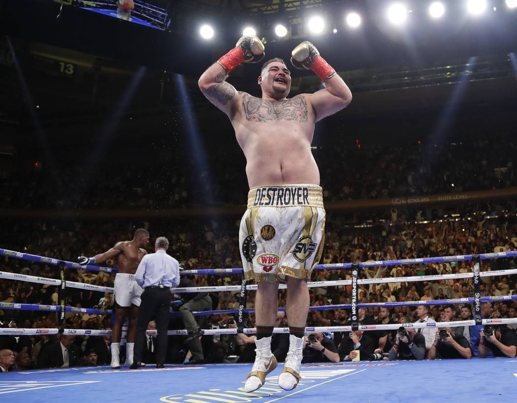 Andy Ruiz celebrates after stopping British boxer Anthony Joshua during the seventh round of a ...