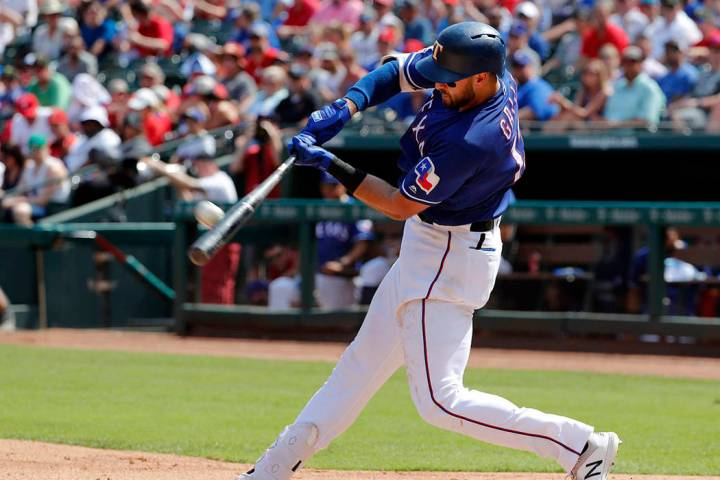 Texas Rangers' Joey Gallo connects for a two-run home run on a pitch from Kansas City Royals' H ...