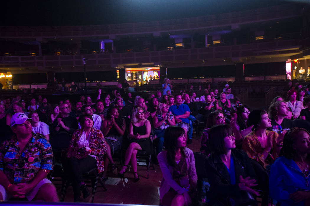 Attendees listen to host John Forte, not pictured, inside The Joint during the first day of the ...
