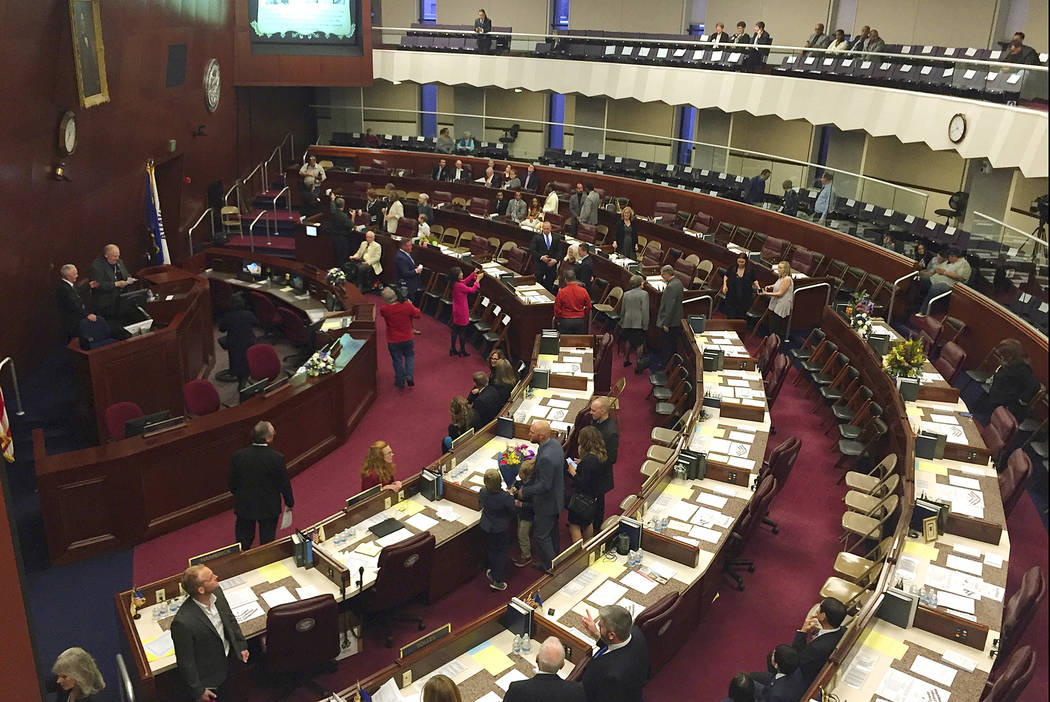FILE - In this Feb. 4, 2019, file photo, assembly members gather before the Nevada State Assemb ...