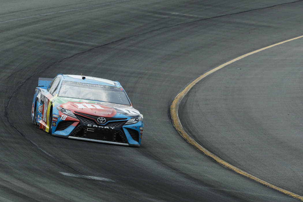 Kyle Busch enters Turn 1 during a NASCAR Cup Series auto race at Pocono Raceway, Sunday, June 2 ...