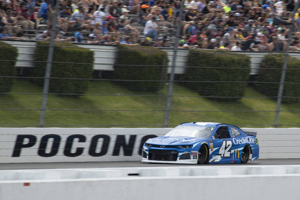 Kyle Larson drives down the front stretch during a NASCAR Cup Series auto race at Pocono Racewa ...
