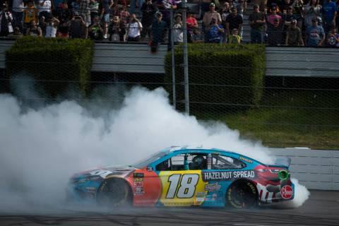 Kyle Busch celebrates after winning a NASCAR Cup Series auto race at Pocono Raceway, Sunday, Ju ...