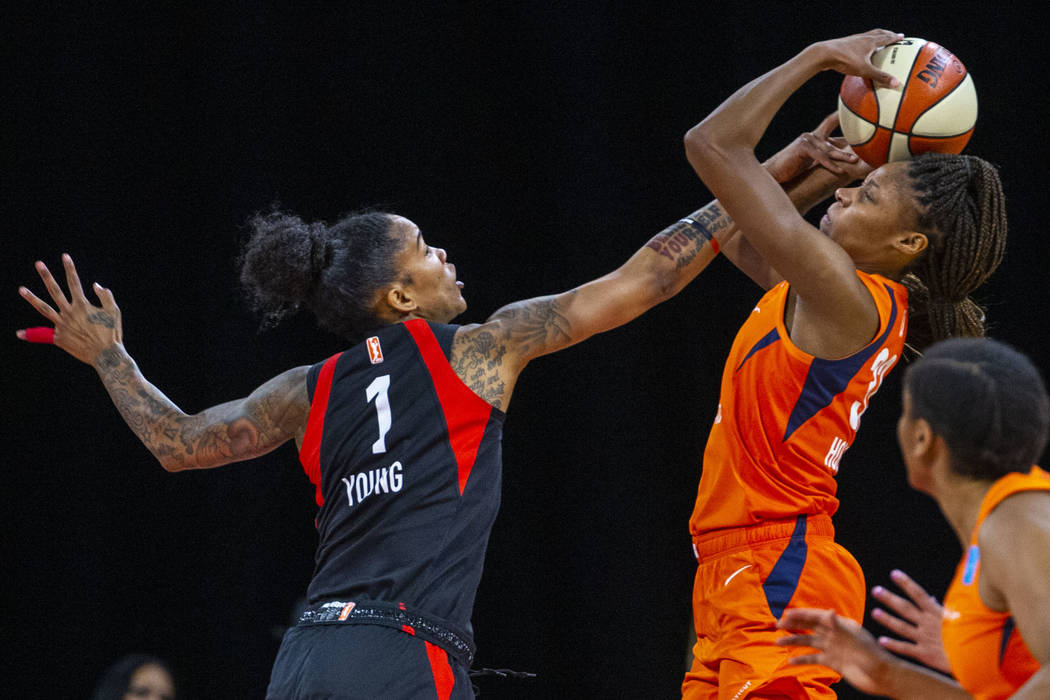 Las Vegas Aces forward Tamera Young (1) defends the basket from Connecticut Sun guard Bria Holm ...