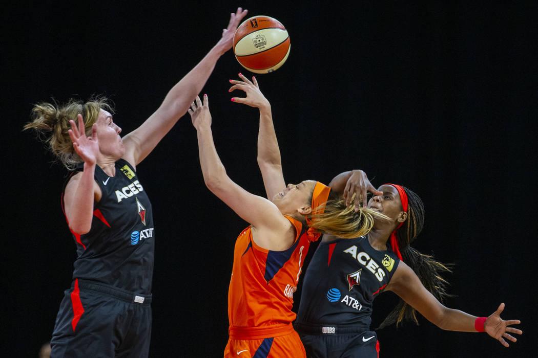 Las Vegas Aces center Carolyn Swords (4) deflects the ball away from Connecticut Sun guard Rach ...