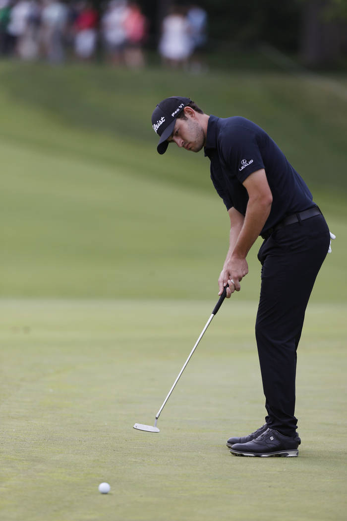 Patrick Cantlay putts on the first hole during the final round of the Memorial golf tournament ...