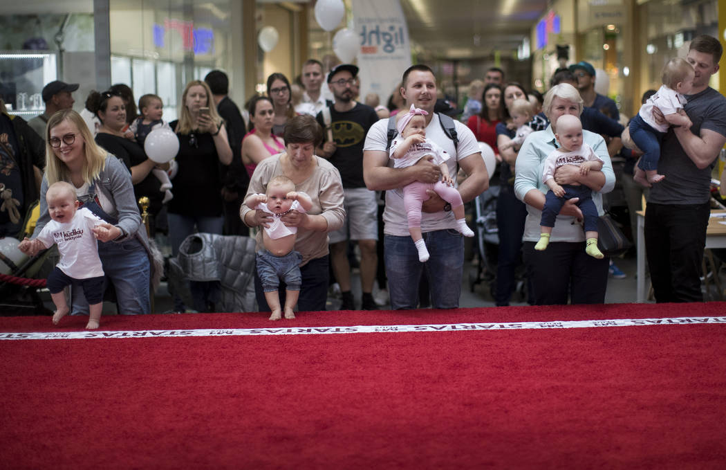 Parents prepare to release their babies during the Baby Race event to mark international Childr ...