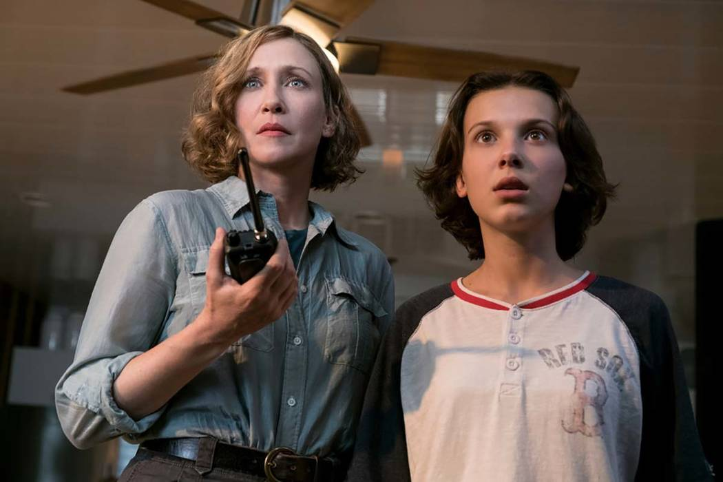 This image released by Warner Bros. Pictures shows Vera Farmiga, left, and Millie Bobby Brown i ...