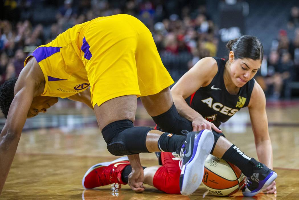 Los Angeles Sparks guard Alexis Jones, left, loses the ball to Las Vegas Aces guard Kelsey Plum ...