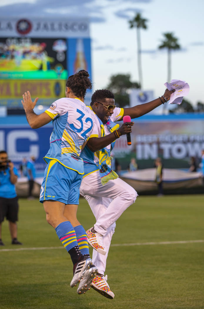 "Las Vegas Lights FC defender Jonathan Levin (32) and hype man Robert ""Bojo"" Ackah bump in the a ..."