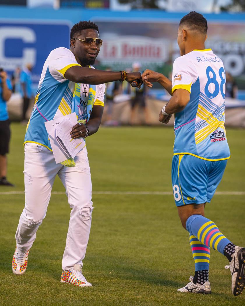 "Las Vegas Lights FC midfielder Junior Sandoval (88) and hype man Robert ""Bojo"" Ackah fist bump ..."