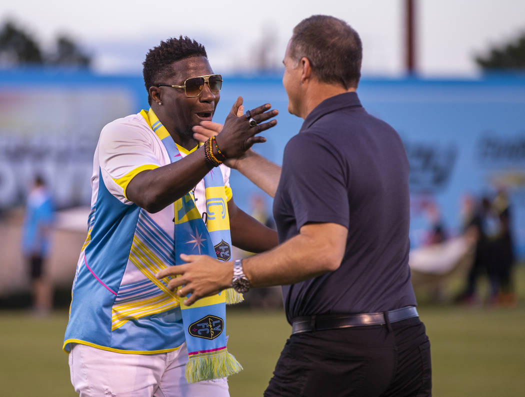 "Las Vegas Lights FC head coach Eric Wynalda and hype man Robert ""Bojo"" Ackah greet each other d ..."