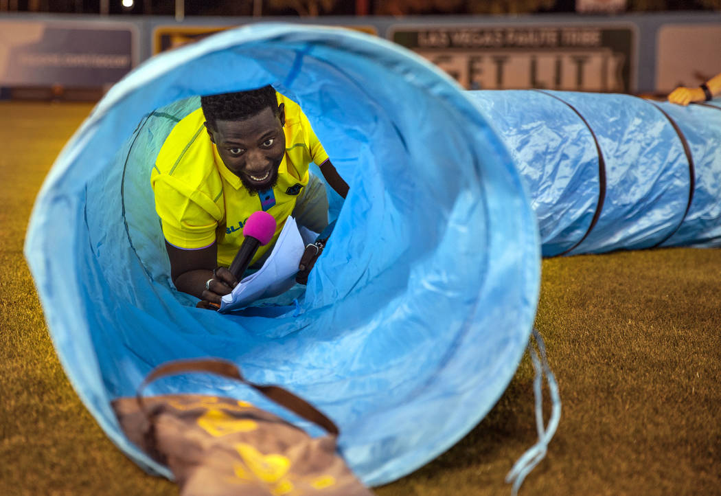 "Las Vegas Lights FC hype man Robert ""Bojo"" Ackah navigates a plastic pip used for a dog obstacl ..."