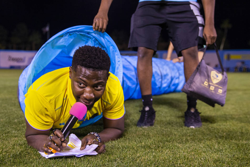 "Las Vegas Lights FC hype man Robert ""Bojo"" Ackak navigates a plastic pip used for a d ..."