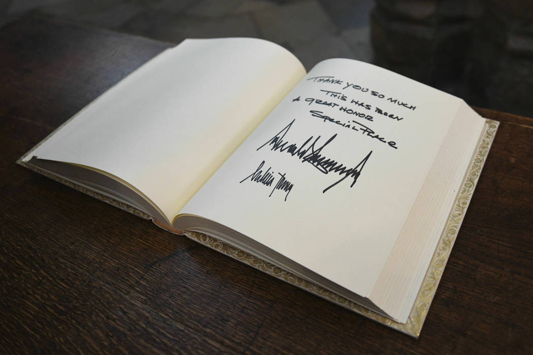 The visitors books signed by US President Donald Trump and his wife Melania after their tour of ...