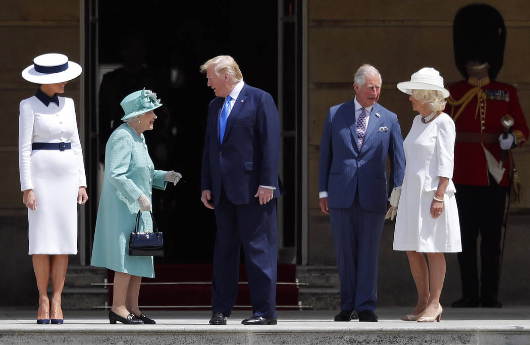 Britain's Queen Elizabeth II greets President Donald Trump, center, and first lady Melania Trum ...