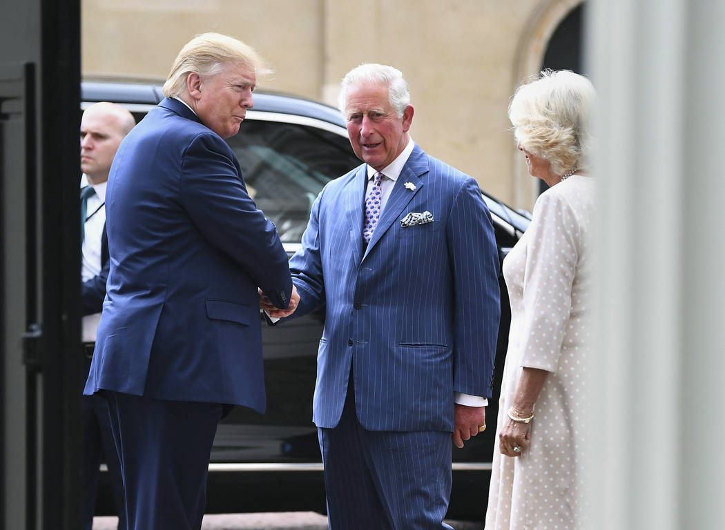 US President Donald Trump, left, is greeted by Britain's Prince Charles and Camilla, the Duche ...