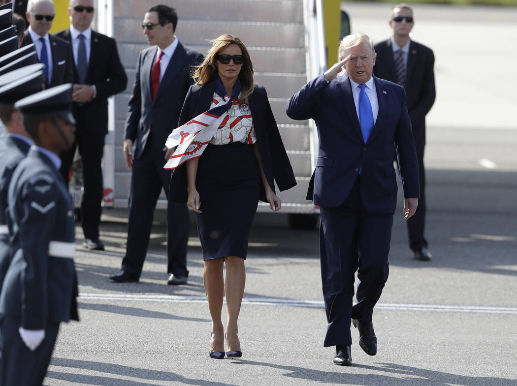 President Donald Trump salutes an honor guard as he and first lady Melania Trump arrive at Stan ...