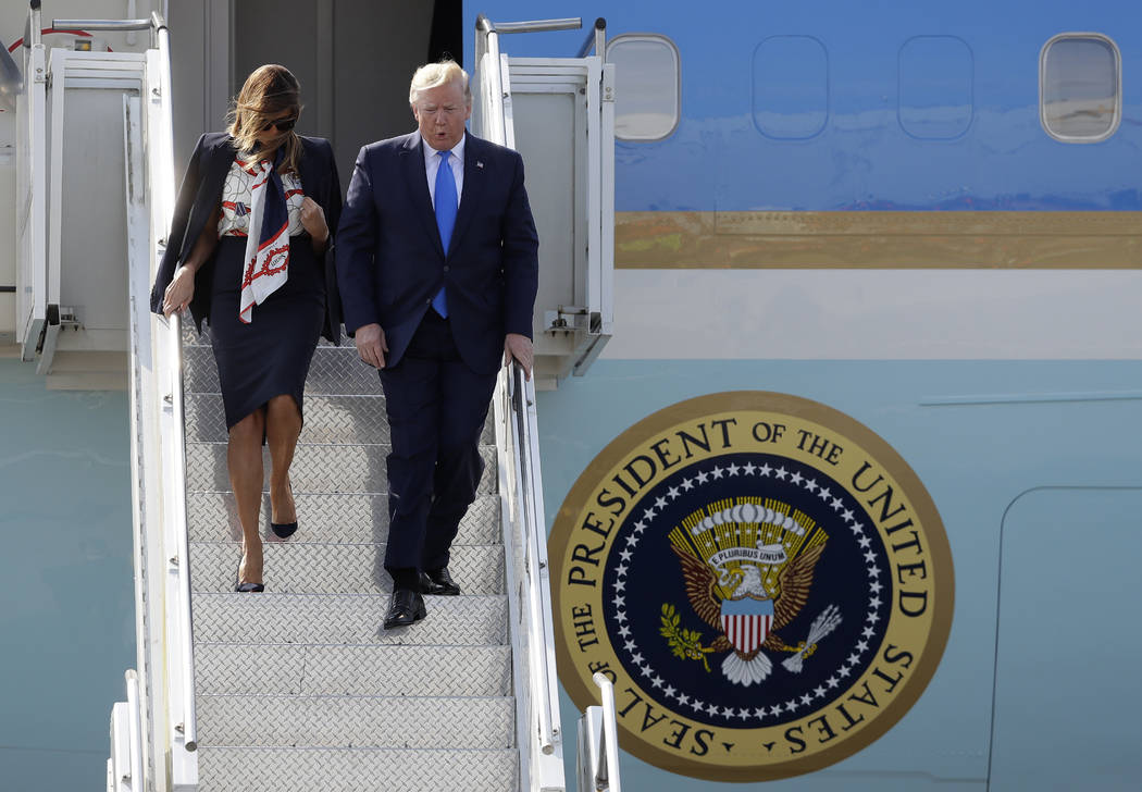 President Donald Trump and first lady Melania Trump arrive at Stansted Airport in England, Mond ...