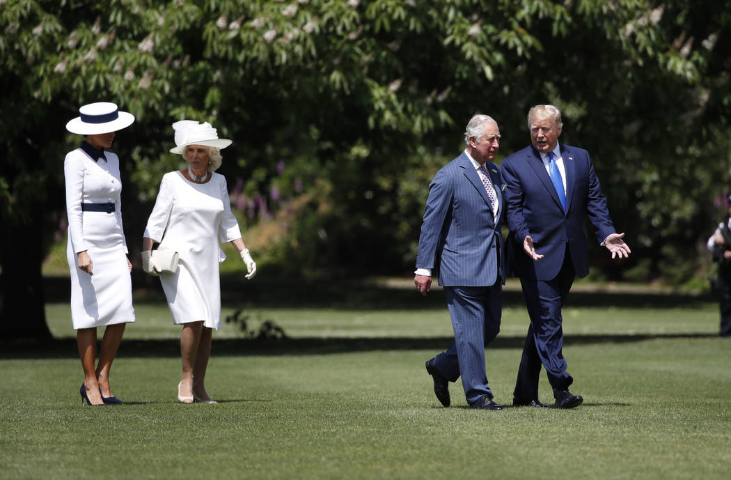 President Donald Trump walks with Prince Charles and first lady Melania Trump walks with Camill ...