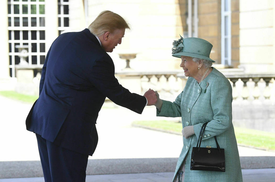 Britain's Queen Elizabeth II greets President Donald Trump as he arrives for a welcome ceremony ...
