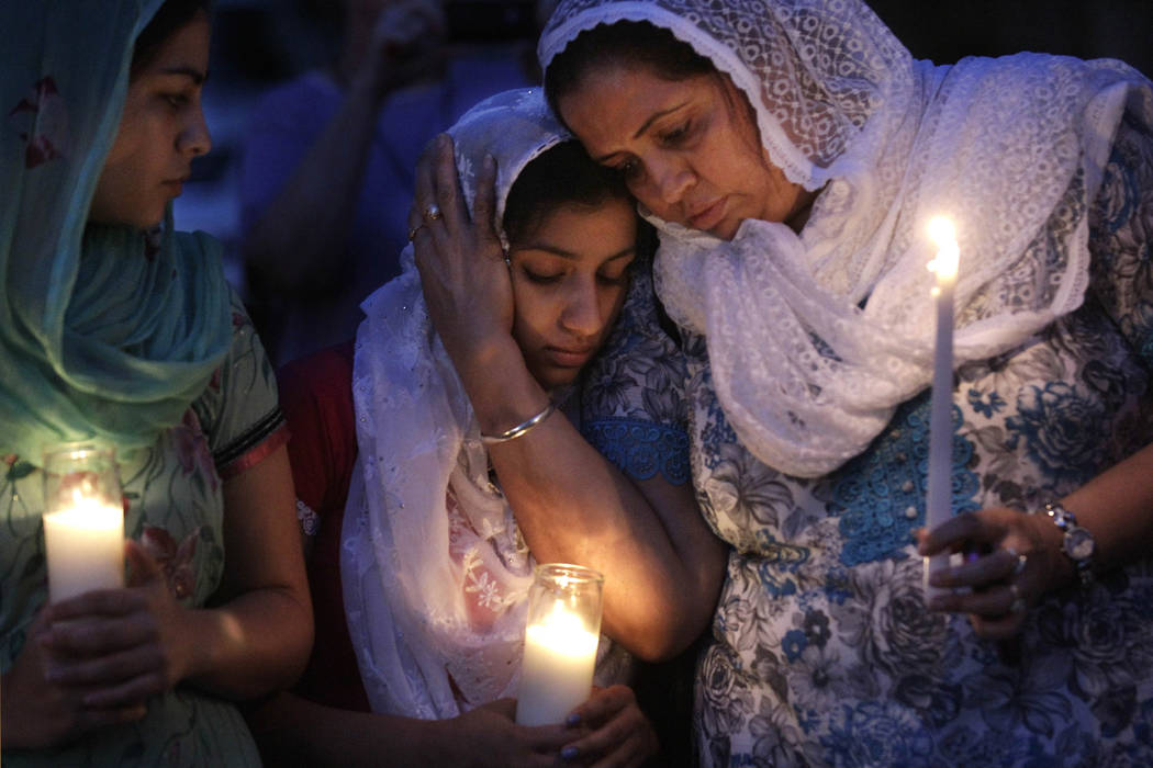 FILE - In this Monday, Aug. 6, 2012 file photo, Sikh worshipers gather for a candlelight vigil ...