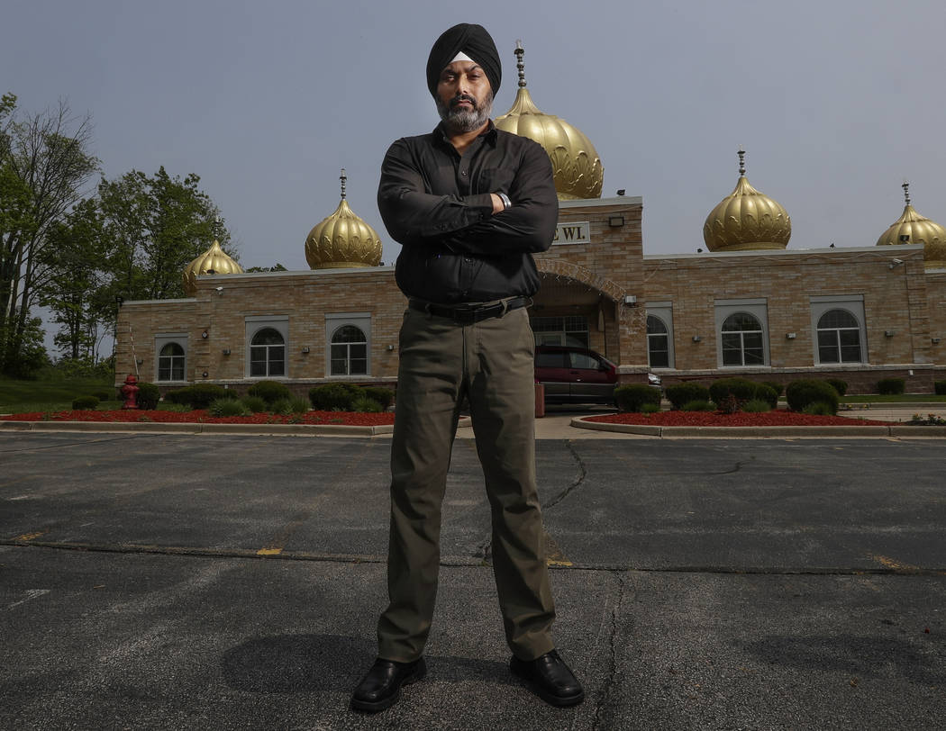 In this Saturday, June 1, 2019 photo, Pardeep Singh Kaleka poses for a portrait outside the Sik ...